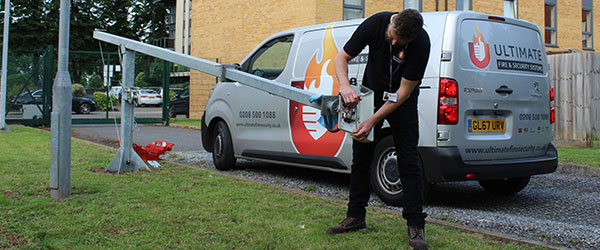 cctv camera being serviced with ultimate fire and security systems