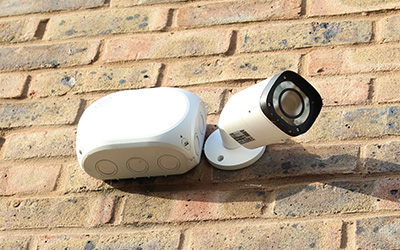 fire and security systems cctv camera installed on brick wall