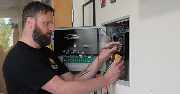 ultimate fire and security engineer testing fire panel
