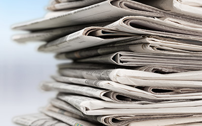 ultimate fire and security newspapers stacked up